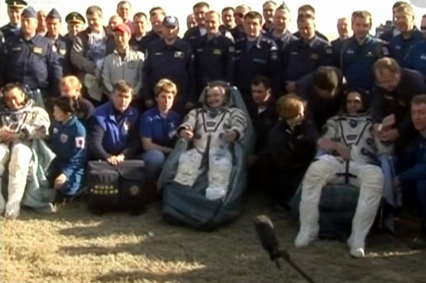 Koichi Wakata, Mikhail Tyurin and Rick Mastracchio assisted after their landing (Photo NASA TV)