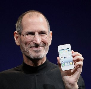 Steve Jobs shows an iPhone 4 in 2010
