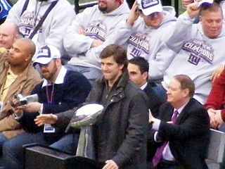 The Super Bowl XLVI MVP Eli Manning with the Super Bowl XLII trophy