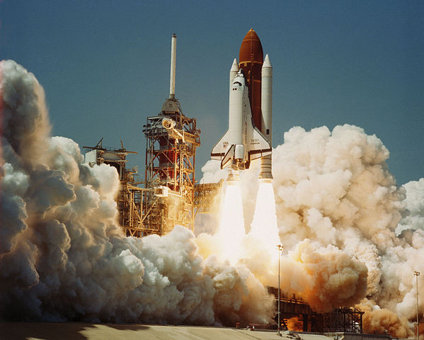 The Space Shuttle Challenger lifting off for its first space mission
