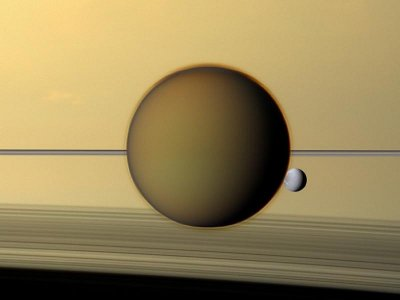 Titan and Dione with Saturn rings in the background (Image NASA/JPL-Caltech/Space Science Institute)