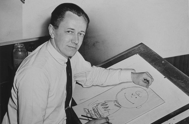 Charles Schulz in 1956 and a Charlie Brown drawing (Photo Roger Higgins, World Telegram staff photographer)