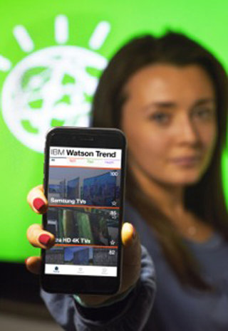 Hannah Egan, product strategy specialist, IBM Commerce, shows the new IBM Watson Trend App (John Mottern/Feature Photo Service for IBM)