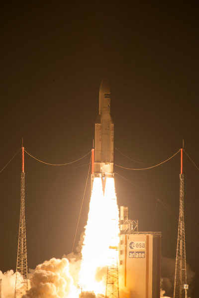 The space freighter ATV-5 Georges Lemaître lifting off on an Ariane 5ES rocket (Photo ESA)