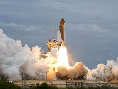 The Space Shuttle Atlantis lifts off for its last mission (photo NASA)