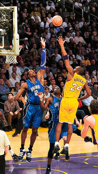 Dwight Howard facing his new teammate Kobe Bryant in 2010