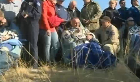 The Russian cosmonauts Oleg Artemyev and Alexander Skvortsov and the American astronaut Steve Swanson assisted after they landed in the Soyuz TMA-12M spacecraft (Image NASA TV)