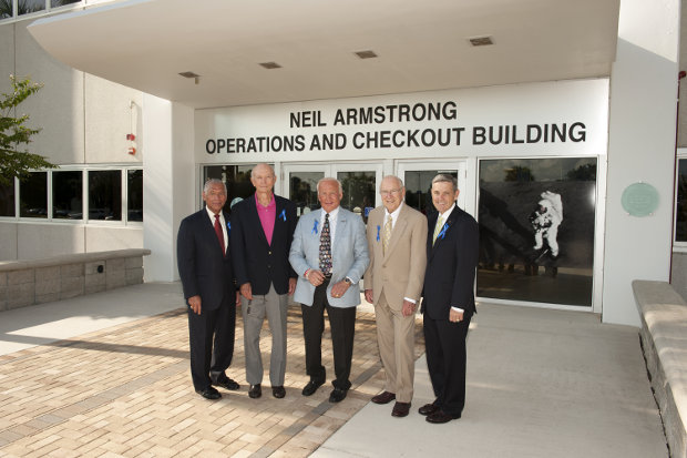 NASA Administrator Charles Bolden, Apollo astronauts Mike Collins, Buzz Aldrin and Jim Lovell, and Center Director Robert Cabana in front of the Neil Armstrong Operations and Checkout Building (Photo NASA/Kevin O'Connell)