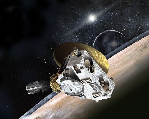 Artistic concept of the New Horizons space probe near Pluto and its satellite Charon (Image Johns Hopkins University Applied Physics Laboratory/Southwest Research Institute)