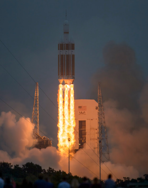The Orion spacecraft blasting off atop a Delta IV Heavy rocket (Photo NASA / Bill Ingalls)
