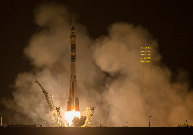 The Soyuz TMA-14M spacecraft blasting off (Photo NASA/Joel Kowsky)