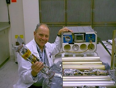 Dr. Dennis Morrison with the Microencapsulation Electrostatic Processing System used on the International Space Station (Photo NASA)