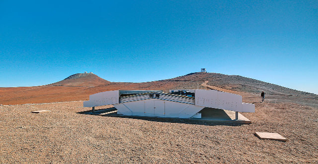 The NGTS dome during the day. In the background the VLT and VISTA domes (Photo ESO/R. Wesson)